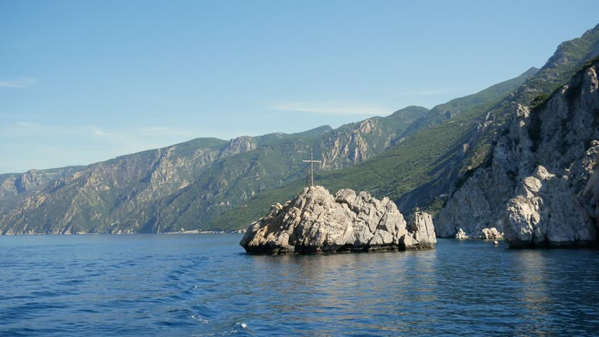 Aegean Sea and cross on rock next to Mount Athos