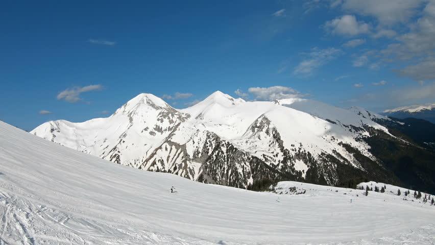 Aerial view from ski lift to ski piste and Pirin mountain range with highest summit Vihren in Bansko, Bulgaria