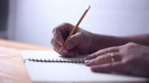 writing hand with the pencil