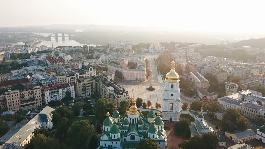 Saint Sophia's Cathedral, square. Kiev Kiyv Ukraine with Places of Interest. Aerial drone video footage. Sunrise light. City panarama. Summer time. Dnipro river and bridge. City center
