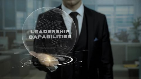 Startup management tutor presents concept Leadership Capabilities using hologram. Entrepreneur in suit holds animated virtual Earth on his hand, when talks about his profession on conference.