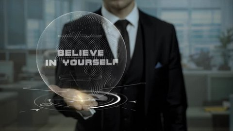 Profession tutor presenting Believe in Yourself concept with hologram on his hand. Executive career specialist looking for workers using cyber Earth hologram.