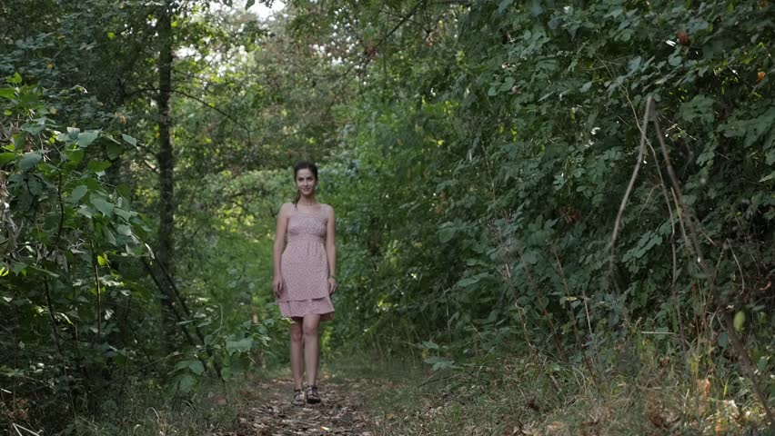 Romantic female walks through the forest slow-mo video #1015808479