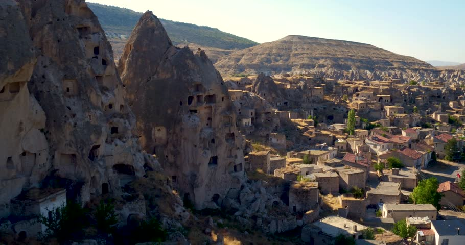 Aerial view of beautiful small village with cave houses in Karain, Cappadocia, Turkey. 4k