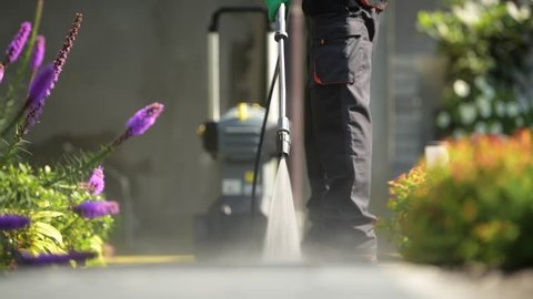 Cleaning Garden Cobble Stone Paths by Pressure Washer.