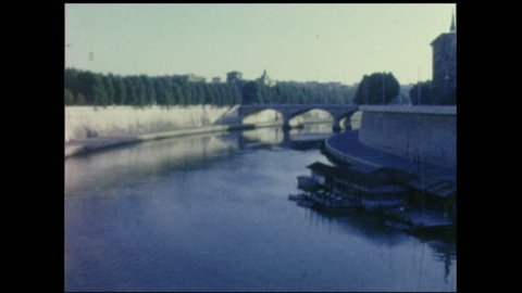River Tiber, two takes also with bridge. Rome 1950's. 8mm vintage footage. Home movies.