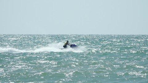 Jet ski on beach. Slow Motions.