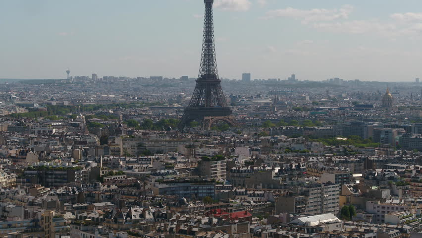 Aerial video of the Eiffel Tower on a sunny day with a zoom lens in Paris France. | Shutterstock HD Video #1015903609