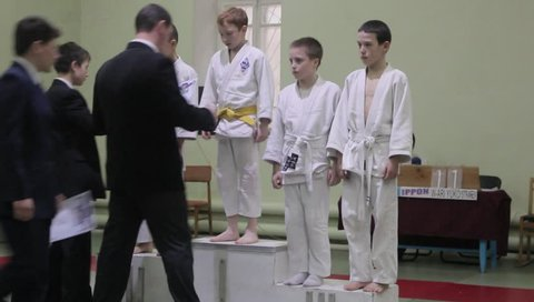Sochi / Russia - August 05 2015: The Awards Ceremony.  Martial arts. children get on the podium