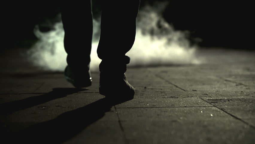 The legs of a man walking near the cloud of a smoke. slow motion | Shutterstock HD Video #1015999849