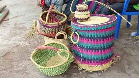 African Art. Colorful hand woven baskets on display in an art market in West Africa.