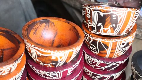 African Art. Colorful patterns on polished wooden bowls in West Africa.