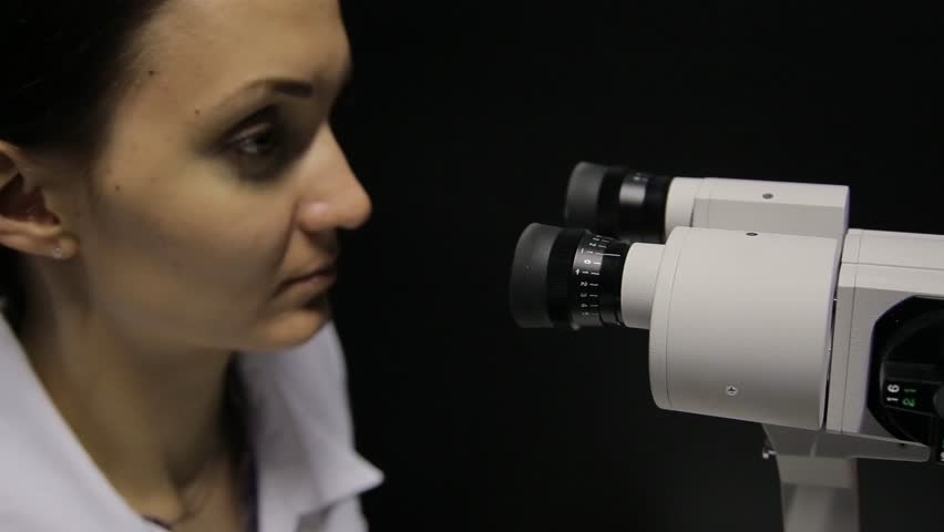 The doctor performs the eye examination of the patient using the newest technology.4K | Shutterstock HD Video #1016057989