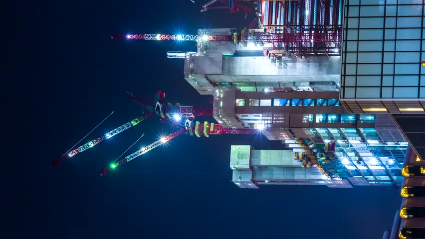 Time Lapse Building Construction Site Night Working (vertical, pan shot) | Shutterstock HD Video #1016070289