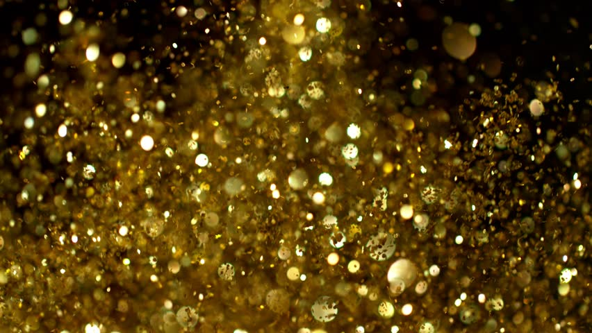 Golden glitter explosion in super slow motion shooted with high speed cinema camera. #1016131969