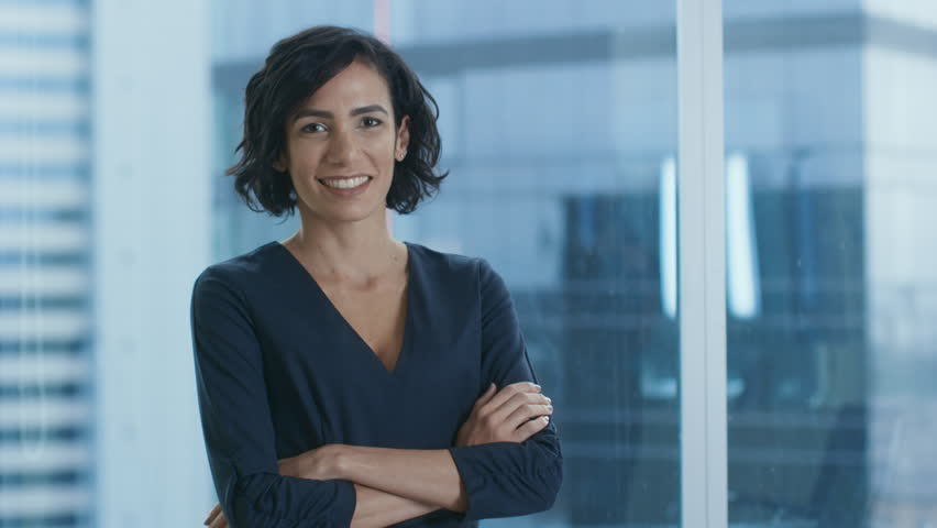 Portrait of the Successful Businesswoman Crossing Her Arms and Smiles. Beautiful Woman Executive Standing in Her Office. Shot on RED EPIC-W 8K Helium Cinema Camera. | Shutterstock HD Video #1016145799