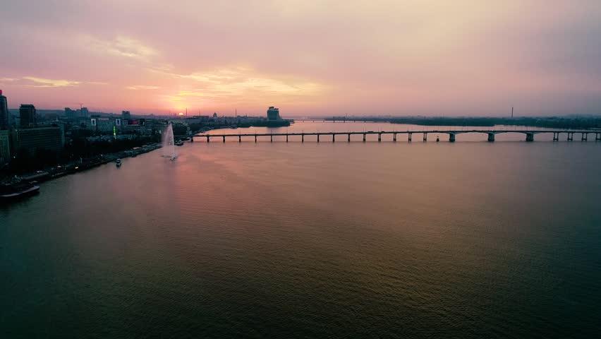 Evening Dnepropetrovsk, bridge over the river, skyscrapers | Shutterstock HD Video #1016150629