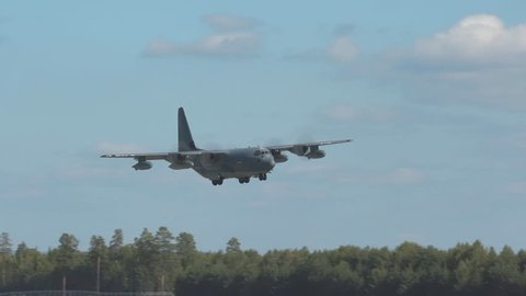 Oslo Airport Norway - ca September 2018: military usaf airplane c130 hercules arrival slow motion