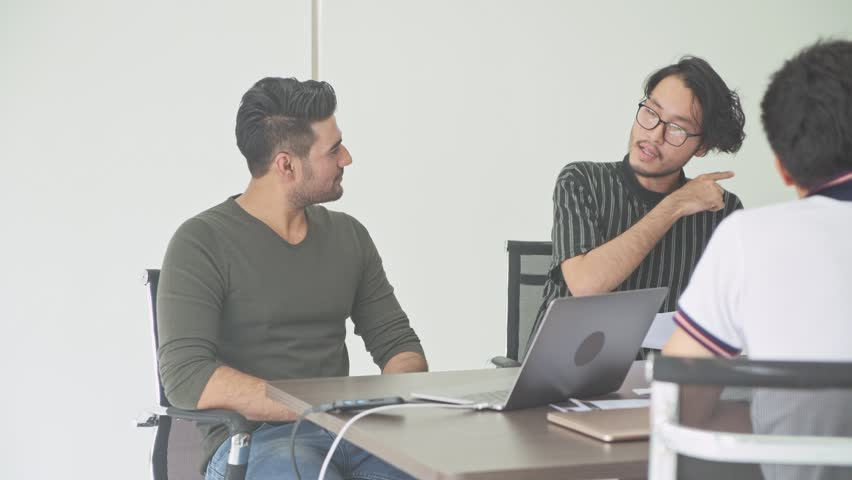 Business meeting. Small start up business meeting in room. Asian team with indian man brainstorming the next big idea. New business model start up concepts. | Shutterstock HD Video #1016216449