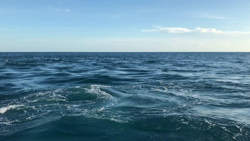 Sea ocean wave with sky blue. | Shutterstock HD Video #1016234959