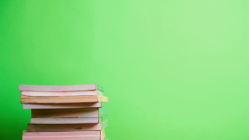 Time lapse of books on green background for reading and education concept | Shutterstock HD Video #1016235109