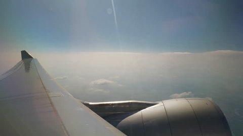 sunny day flying airplane engine passenger window view panorama 4k china