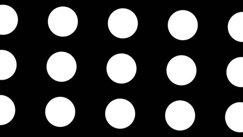 Spinning black circles or dots in a rotating CGI high definition motion black and white backdrop & background video clip