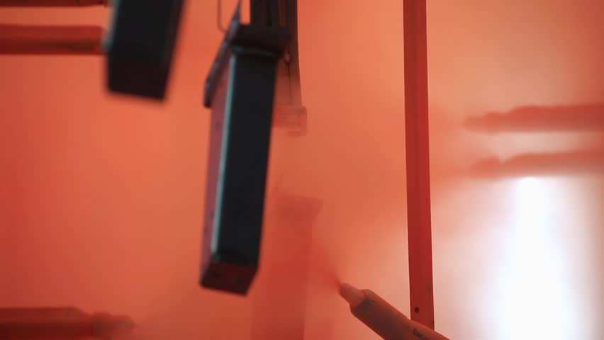 Painting Profiles At The Factory In Orange Paint Conveyor Paints Metal Profile Hang On And Go To