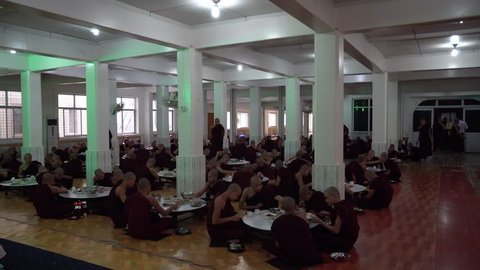 BAGO, MYANMAR -August 19, 2018: Monks having lunch in the monastery at Bago Myanmar. Buddhism in Myanmar is predominantly of the Theravada tradition, practised by 89% of the country's population