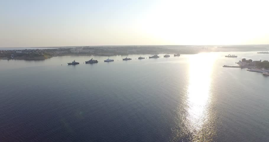 Shooting from the air of  Sevastopol bay, warships in the roads, Russian Navy Day 2015 | Shutterstock HD Video #1016330419
