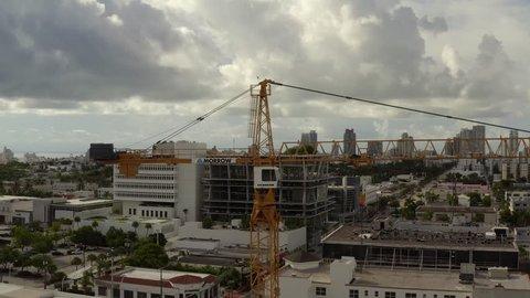 MIAMI BEACH, FLORIDA, USA - SEPTEMBER 9, 2018: Liebherr crane at a construction site