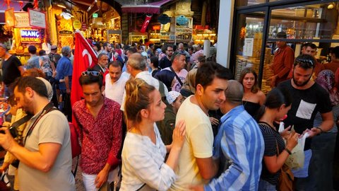 ISTANBUL - AUG 26, 2017: Slow Mo. Crowds of people walking through the Tahtakale Shopping Street next to Egyptian Spice Market in Istanbul. Place is super jam-packed during the holiday season