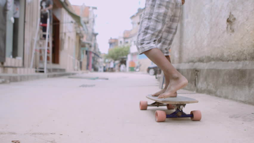 Child Skateboards Through Favela Slow Motion | Shutterstock HD Video #1016355559
