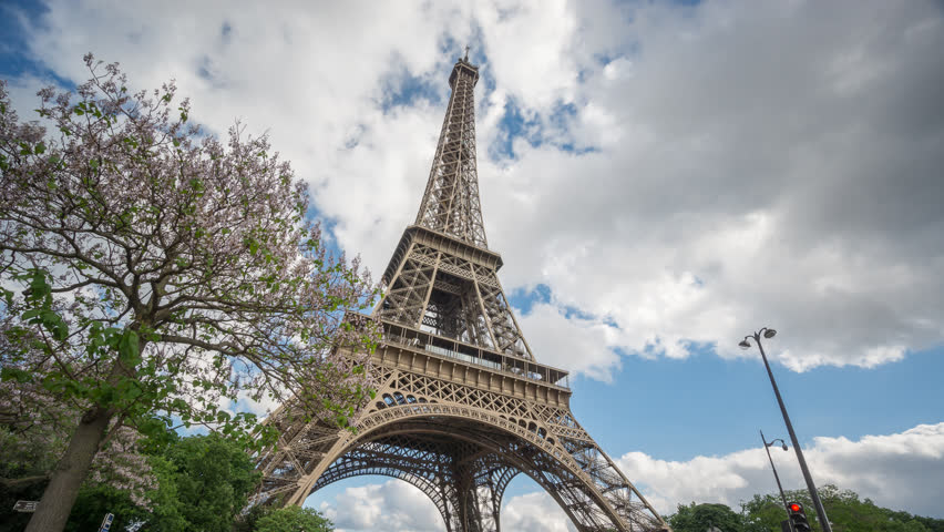 Bottom view Time-lapse of The Eiffel Tower in Paris with blurred cars | Shutterstock HD Video #10163609