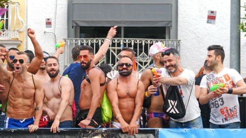 Torremolinos, Spain. June 2018. Group of men dancing in the parade of the Gay Pride. Slow motion.