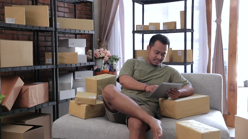 Happy asian online seller preparing their product to be shipped to customer | Shutterstock HD Video #1016372539