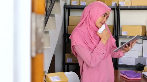 woman working in package delivery service office