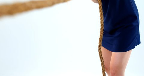Woman pulling a rope tug of war against white background 4k