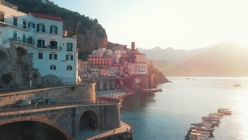 A view of the Amalfi cliff side road where one can see the perfect view of the sea. | Shutterstock HD Video #1016463499