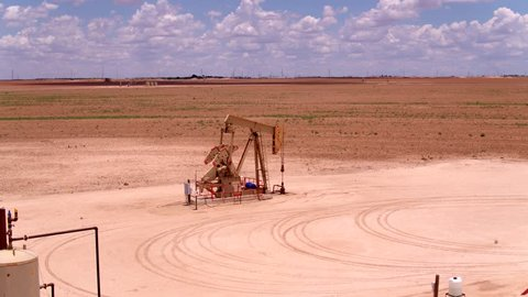 Cinematic Sunny Day Permian Basin Oilfield Pumpjack Aerial Shot