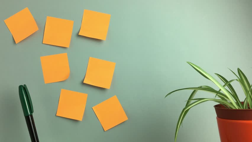 Paper notes that are popped up on the wall. | Shutterstock HD Video #1016465419
