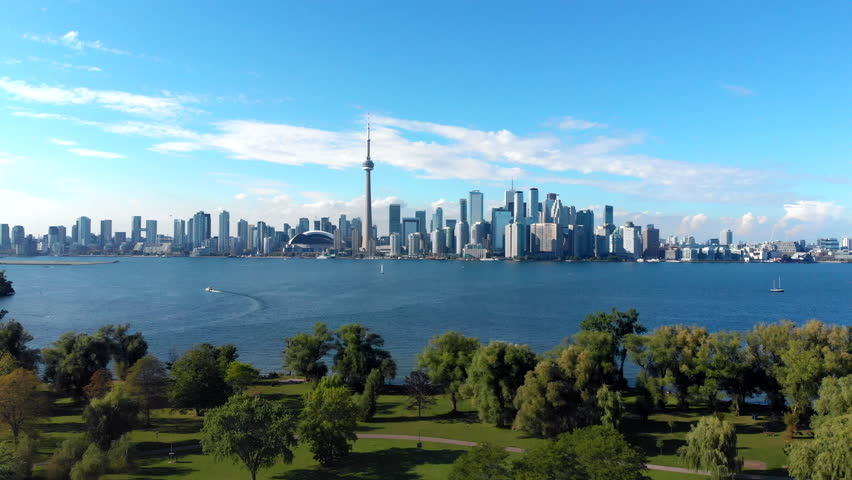 Aerial view of Toronto skyline including Centre Island and Lake Ontario on a summer day in Toronto, Ontario, Canada. | Shutterstock HD Video #1016465929
