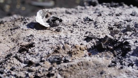 Bonfire ashes close up in slow motion