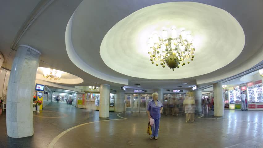 Entrance to Universitet metro station on Saltivska Line of Kharkiv metro timelapse hyperlapse, with a passengers near ticket machines, in Kharkov, Ukraine