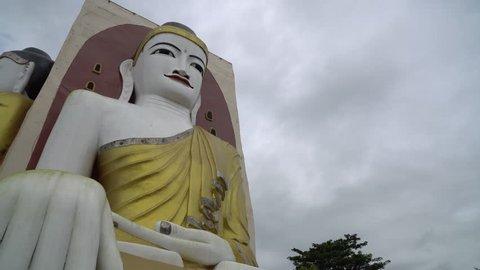 BAGO,MYANMAR - AUGUST 19,2018 : Four Faces of Buddha at Kyaikpun Buddha, in Bago, Myanmar, in the rainy season