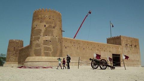 QATAR, DOHA, MARCH 28, 2018: People near Al Zubara Fort or Al Zubarah Fort - historic Qatari military fortress, built in time of Sheikh Abdullah bin Jassim Al Thani in 1938, Qatar, Arabian Peninsula