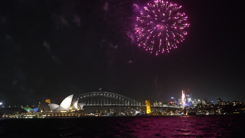 4k UHD cinematic establishing shot of fireworks at Sydney city skyline.