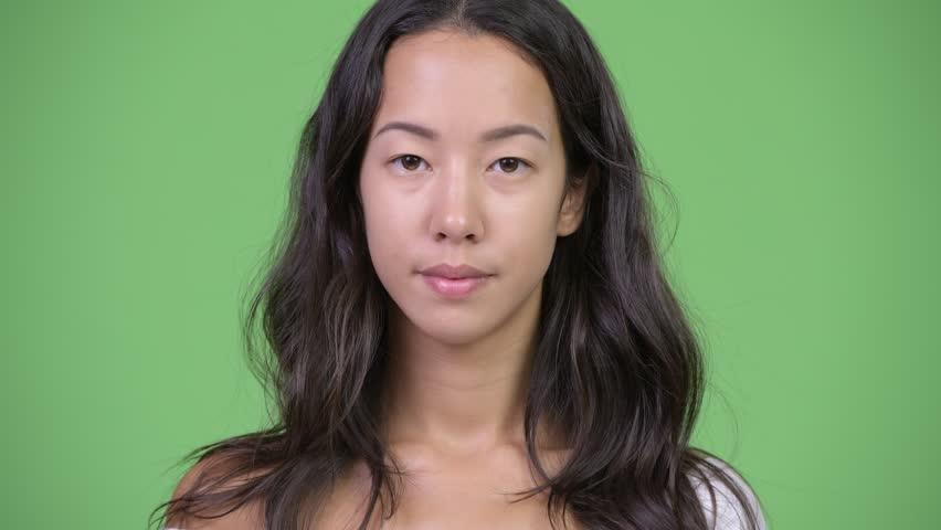 Head shot of young beautiful multi-ethnic woman | Shutterstock HD Video #1016554909