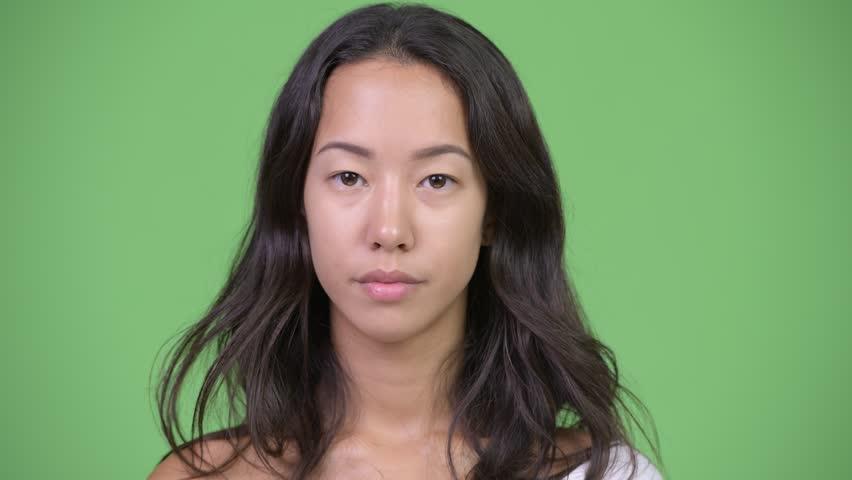 Young beautiful multi-ethnic woman looking bored | Shutterstock HD Video #1016555449