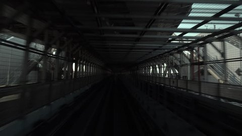 the Tokyo subway going through a bridge